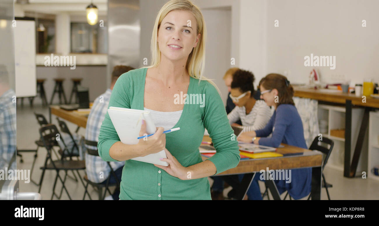 Young female worker with documents - Stock Image