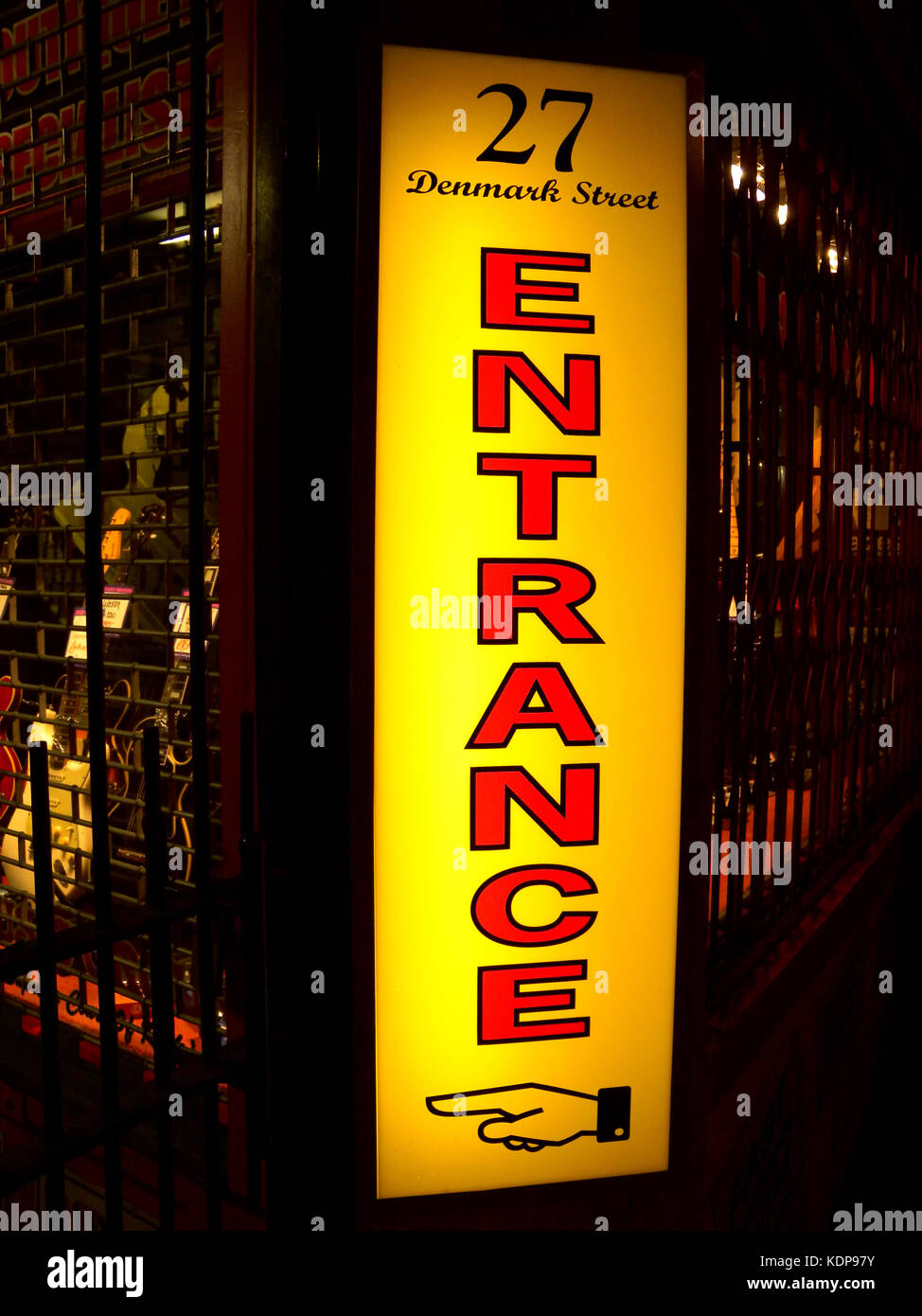 1997, night-time and the close-up picture shows the brightly coloured red and yellow neon 'Entrance' sign - Stock Image