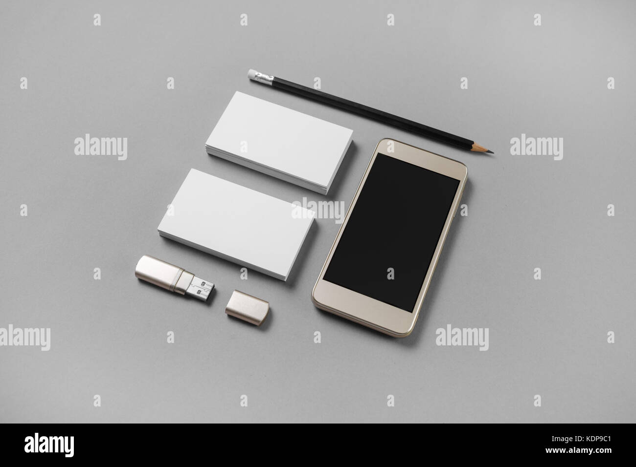 Gadgets and stationery. Mockup of blank business cards, pencil, usb ...