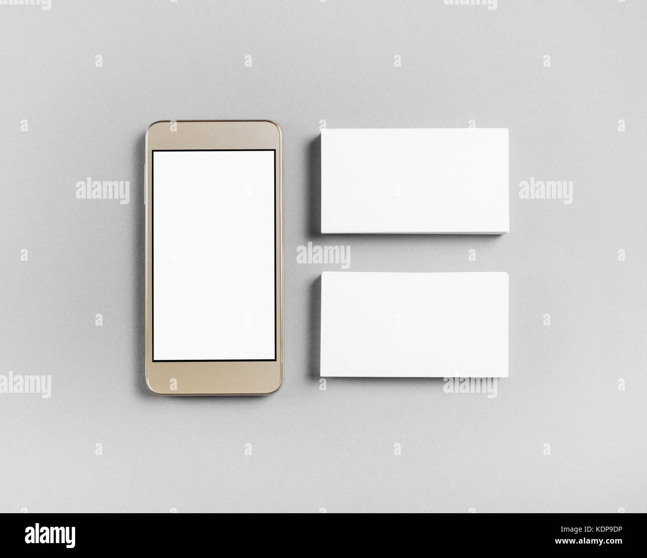 Blank business cards and smartphone on gray paper background blank business cards and smartphone on gray paper background objects for placing your design top view reheart Gallery