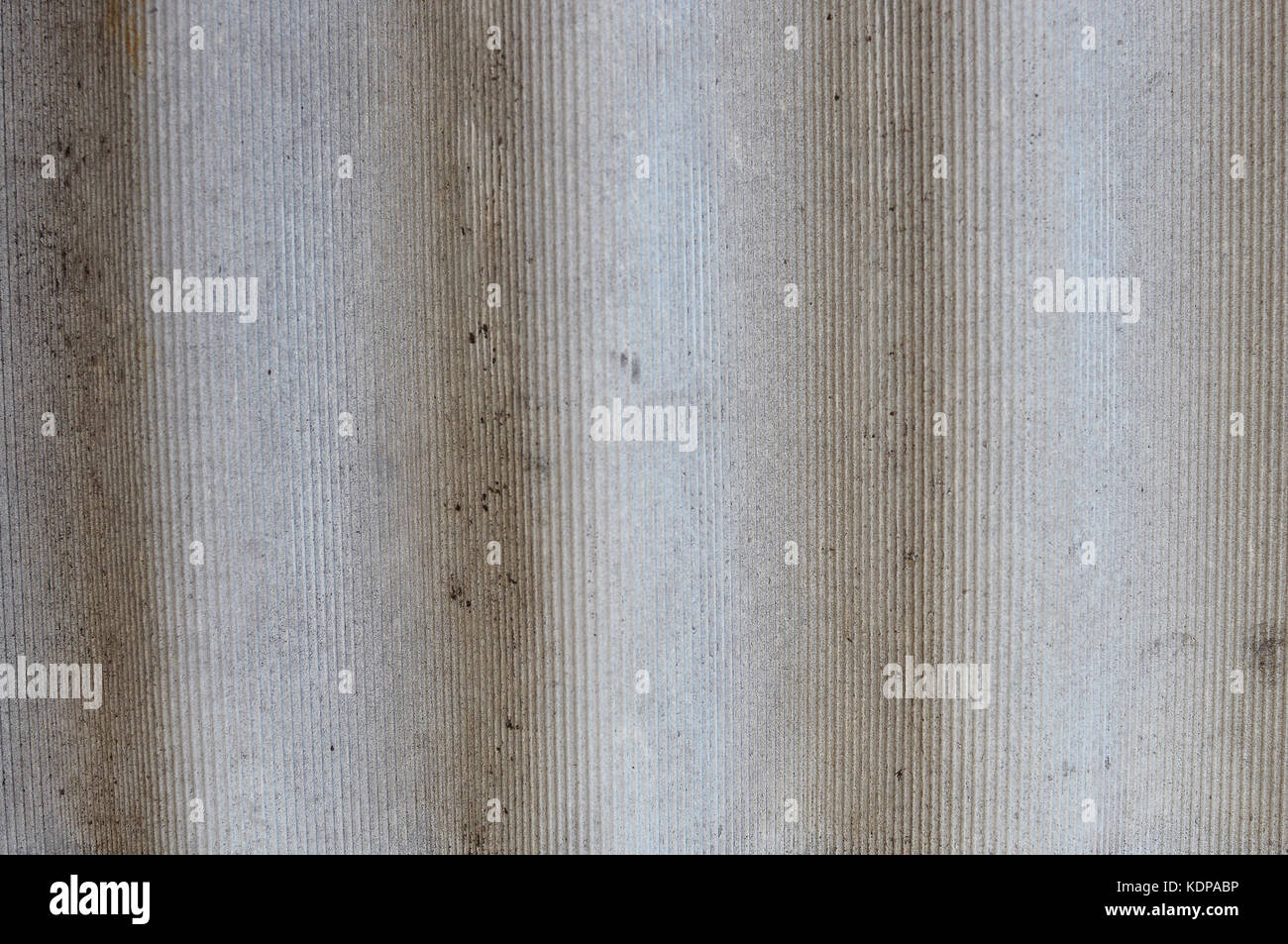 Close-up texture of gray wavy slate sheet fragment. Horizontal orientation. Selective focus - Stock Image