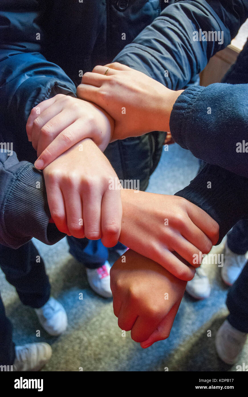 Boys hands expressing union. - Stock Image