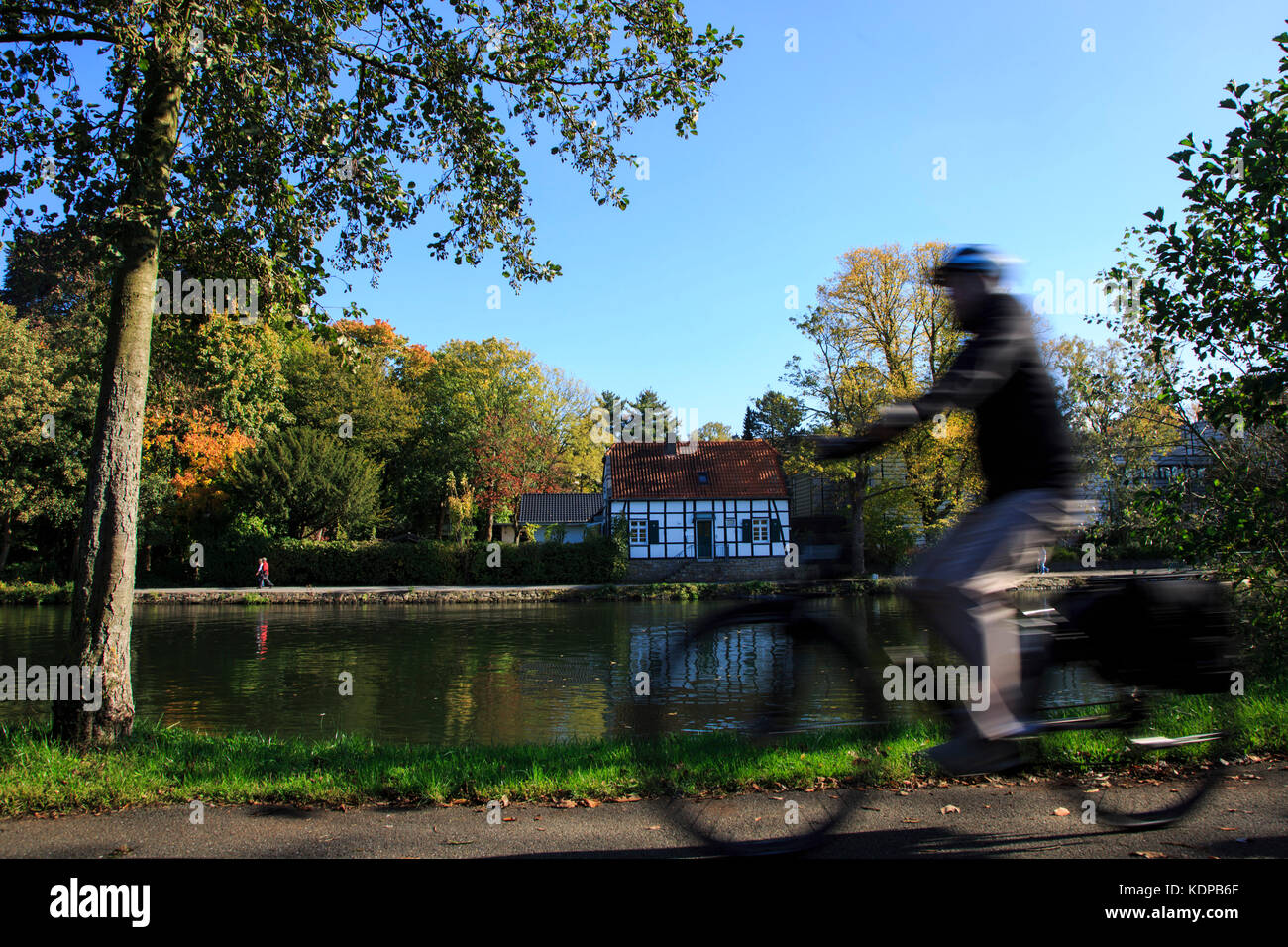 Cyclist on the bank of the Ruhr river, Mülheim an der Ruhr, Germany Stock Photo