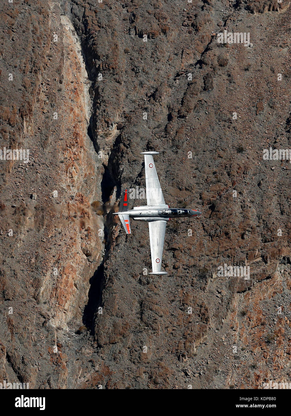 Fouga CM.170 Magister makes a low pass through the Jedi transition in Death Valley National Park, California USA. - Stock Image