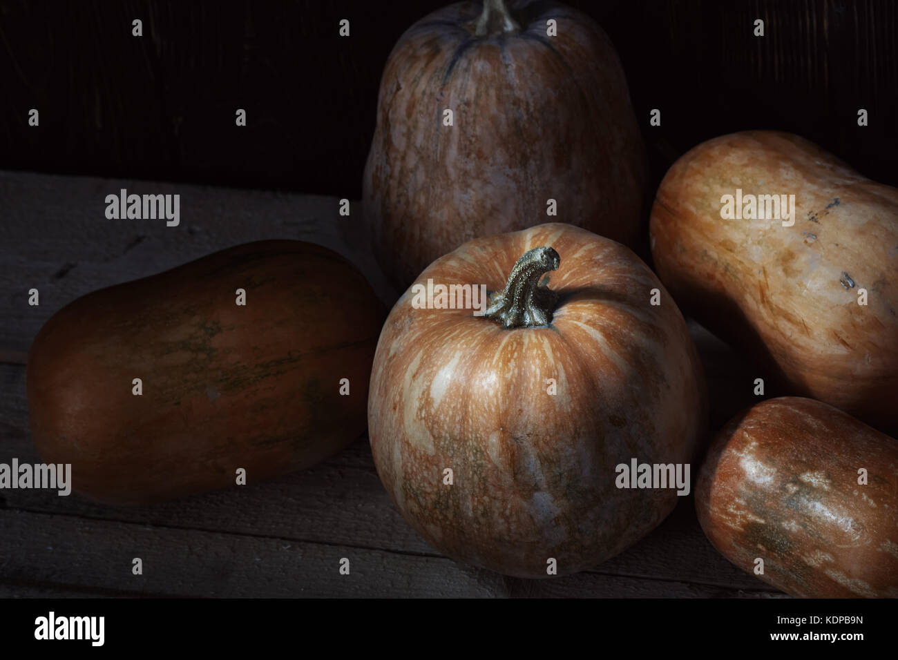Group of pumpkins on a wooden table. High angle view Stock Photo