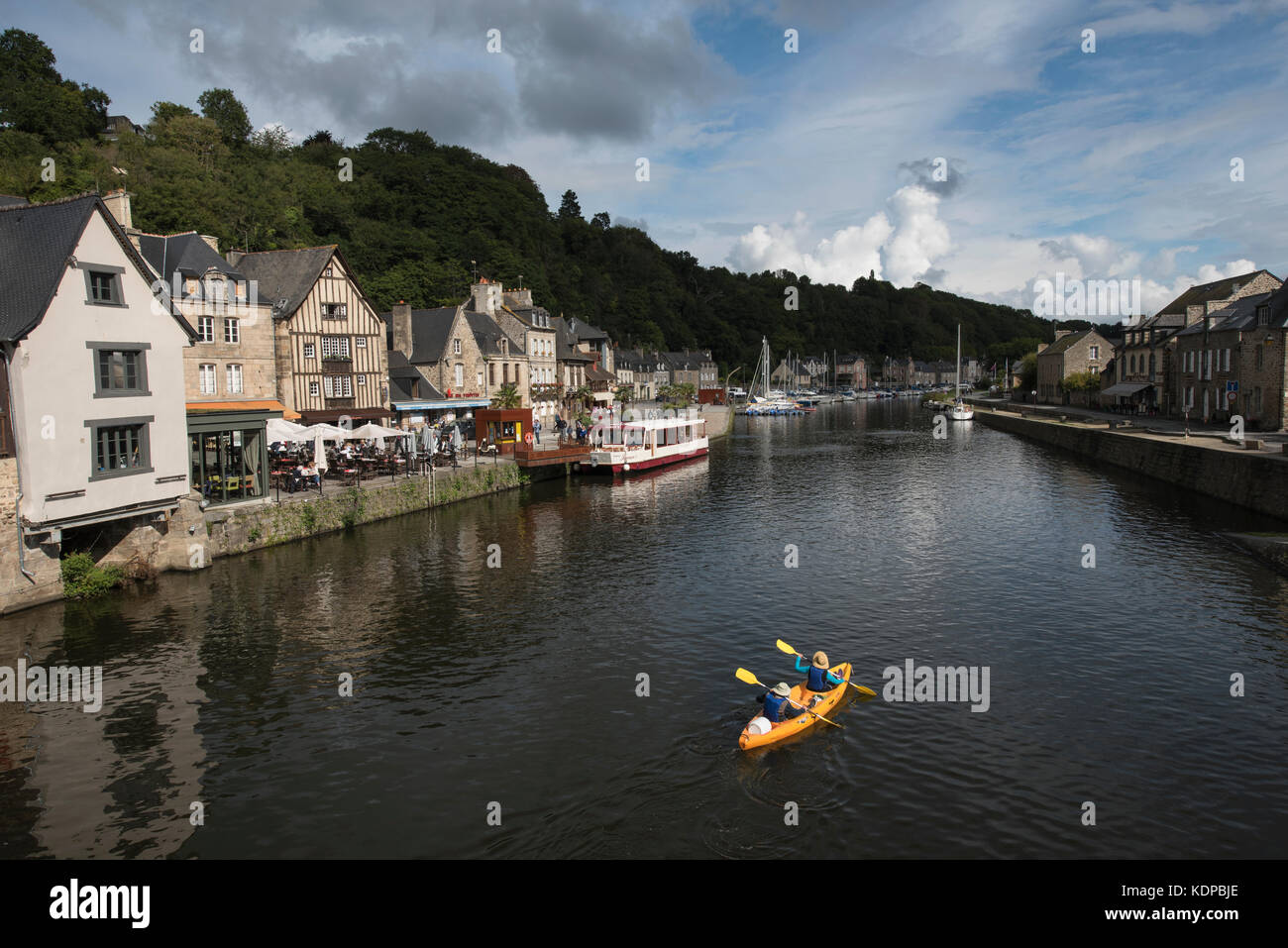Canoeists on River Rance, Dinan, Brittany, France. Stock Photo