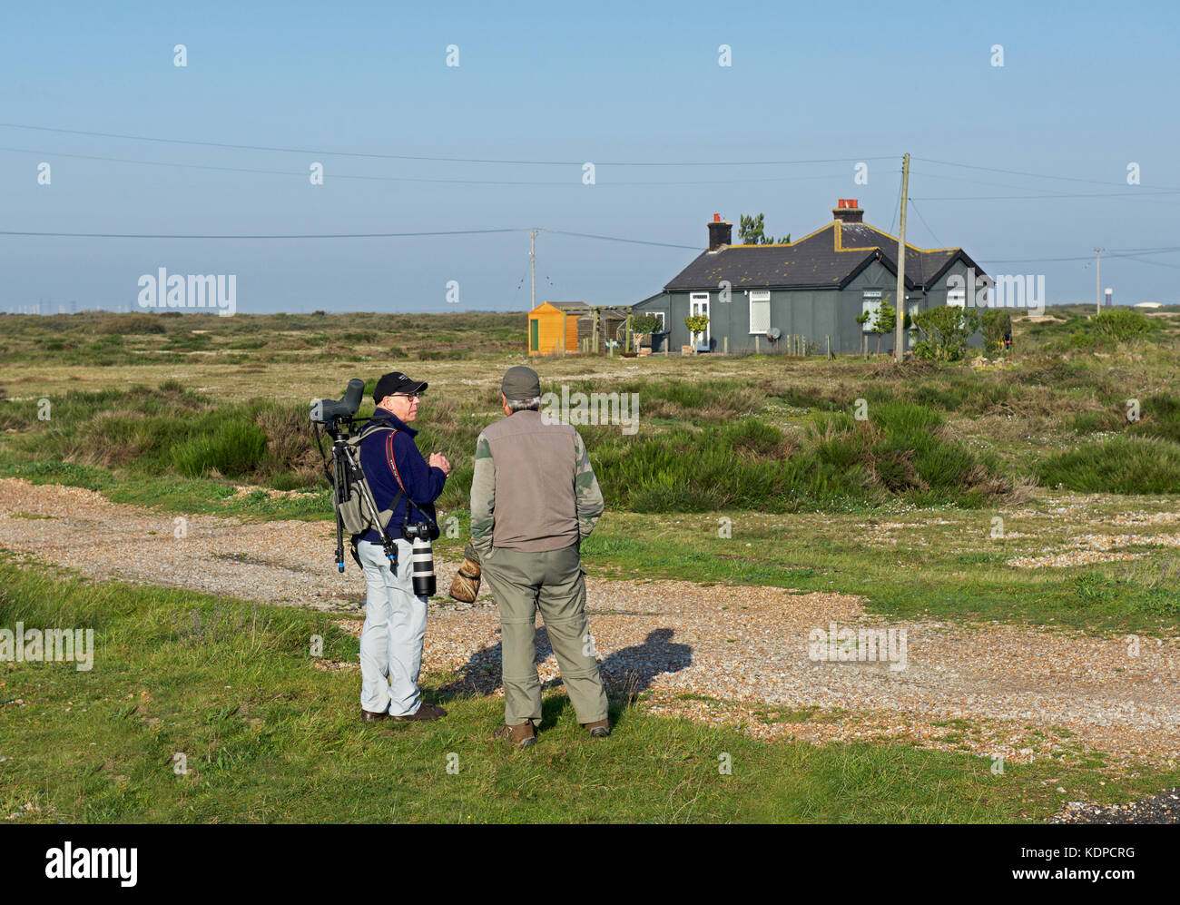 Two bird-watchers at Dungeness, Kent, England UK - Stock Image