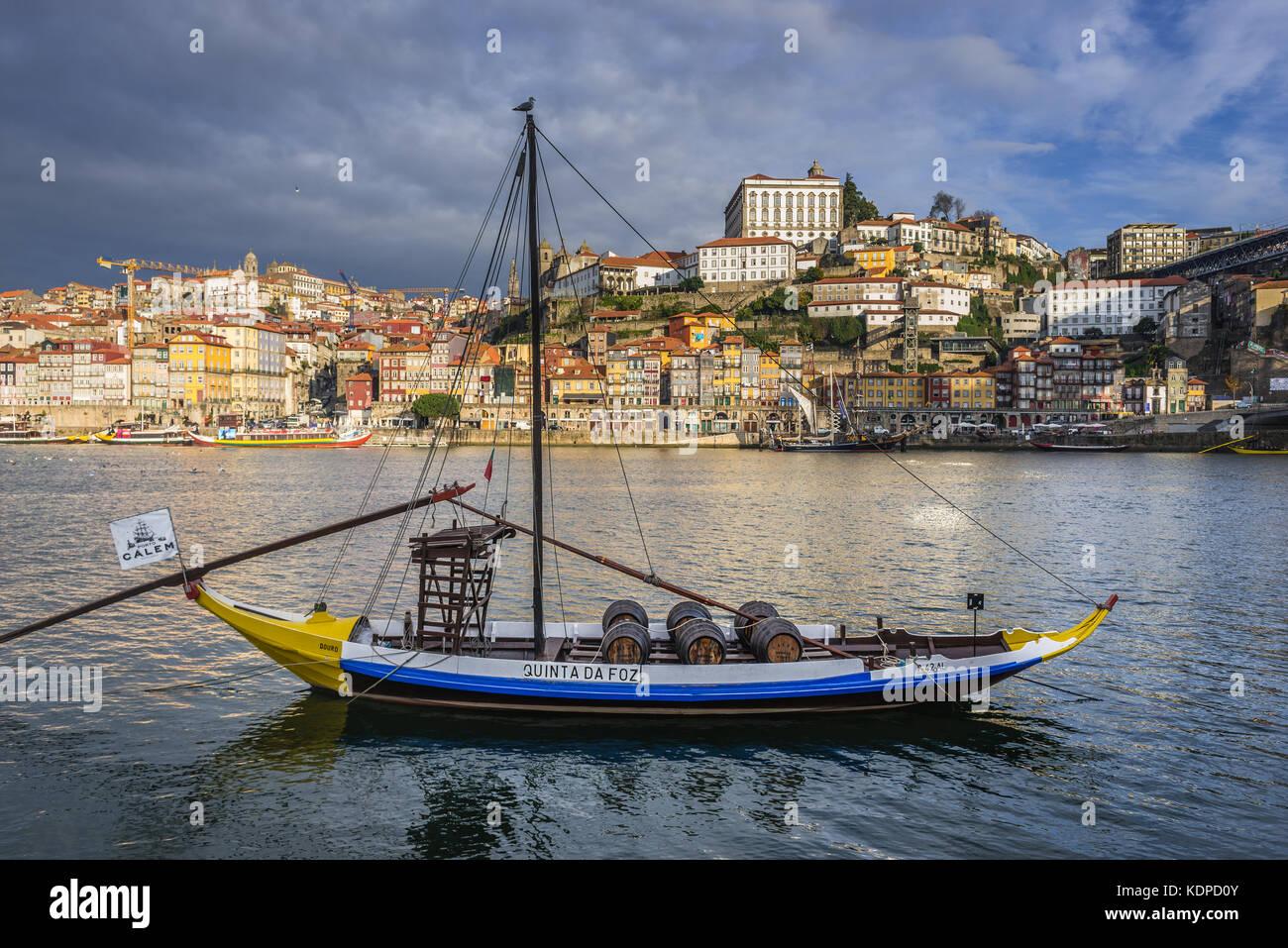 Calem Port wine boat called Rabelo Boat on a Douro River in Vila Nova de Gaia city. Porto city river bank on background Stock Photo