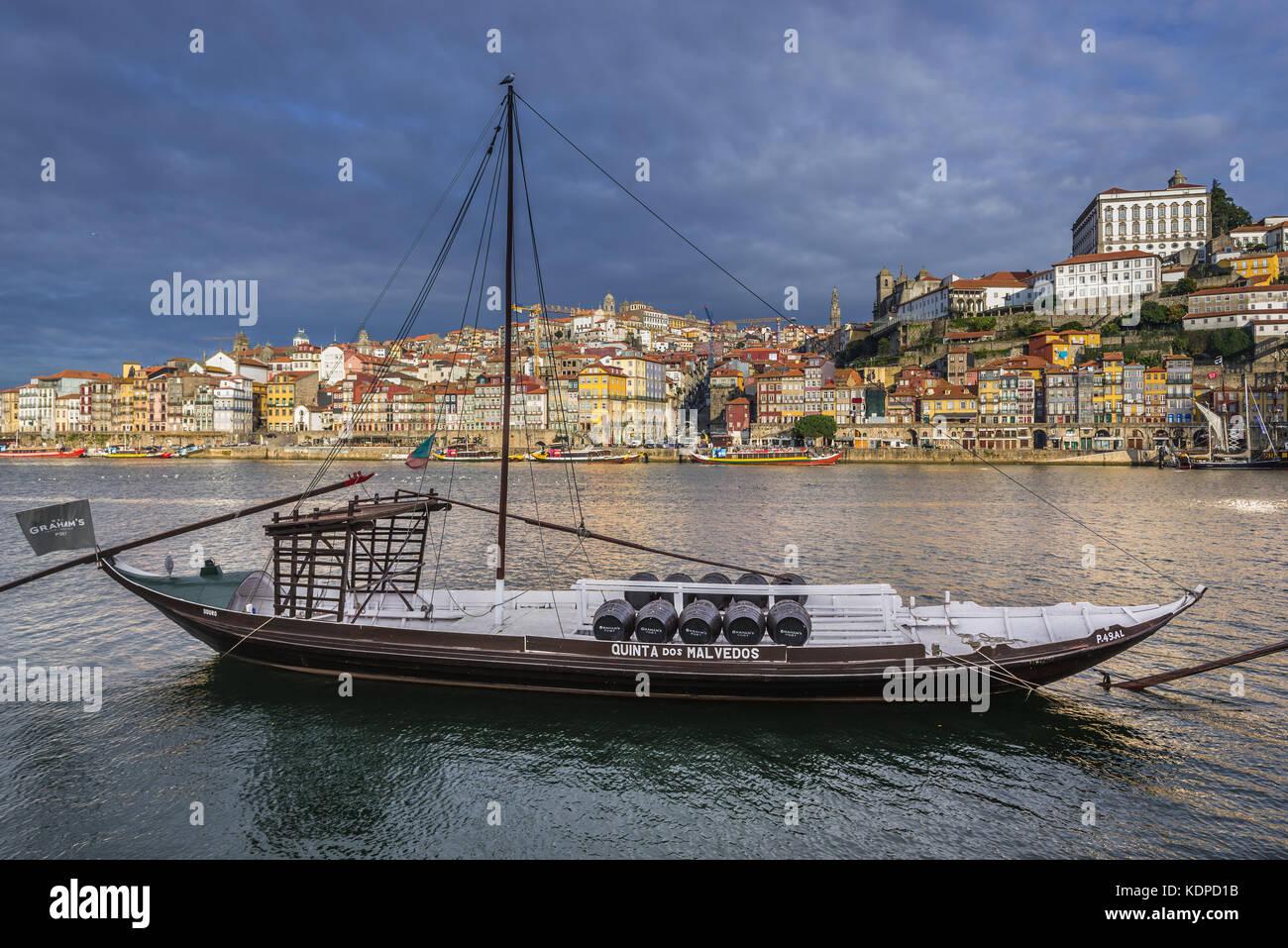 Graham's Port wine boat called Rabelo Boat on a Douro River in Vila Nova de Gaia city. Porto city river bank on Stock Photo