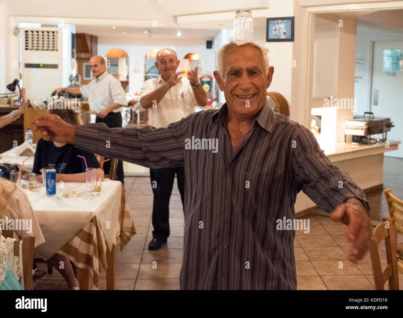 A male dancer performs a traditional Cypriot dance in the New Kings of Aphrodite taverna in Paphos Cyprus. - Stock Image