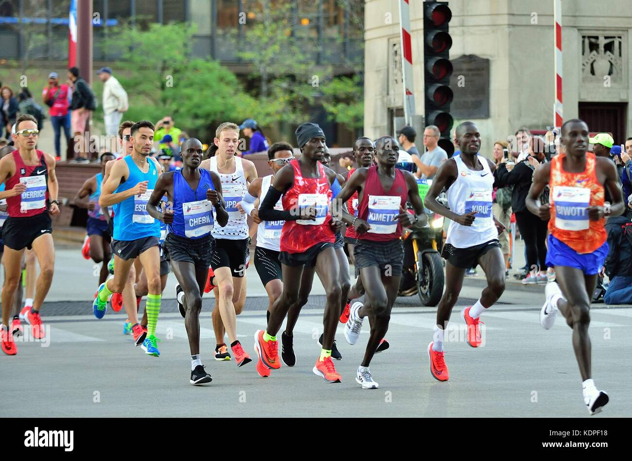 Cluster of 11 elite men marathon runners as they crossed the State Street Bridge at the 2017 Chicago Marathon. Chicago, - Stock Image