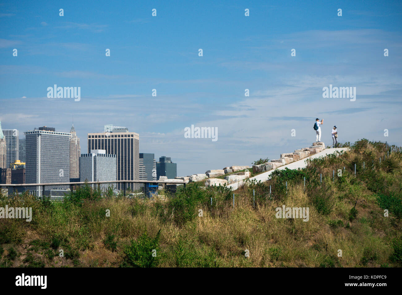 A view of the Manhattan (New York city) skyline from atop 'The Hills' on Governors Island. - Stock Image