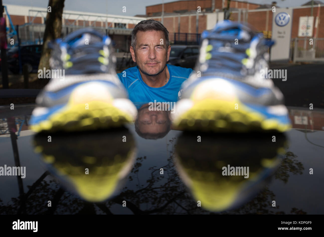 Scottish long-distance runner John McGurk poses with his shoes at a Volkswagen production site in Osnabrueck, Germany, - Stock Image