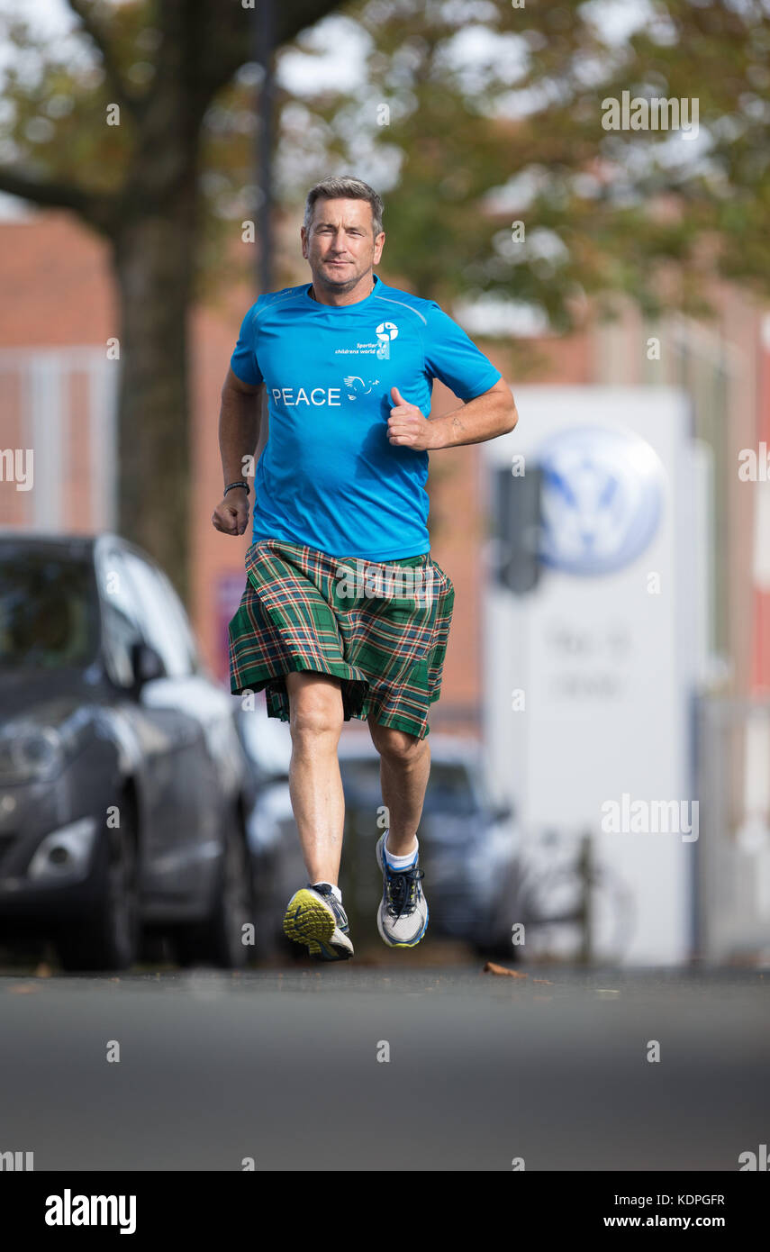 Osnabrueck, Germany. 13th Oct, 2017. Scottish long-distance runner John McGurk runs at a Volkswagen production site - Stock Image
