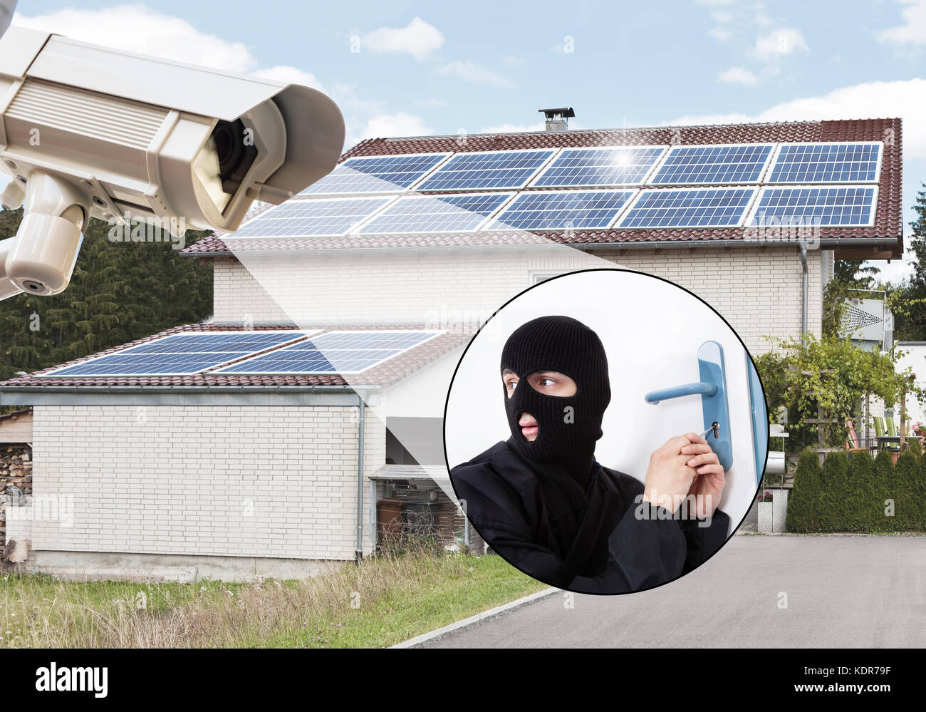 Security Camera Capturing Thief Trying To Enter The House While Opening Door Lock - Stock Image