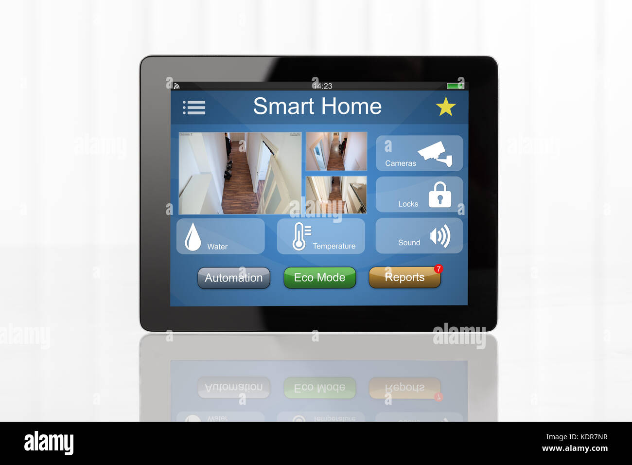 Digital Tablet Showing Home Automation System On White Desk - Stock Image