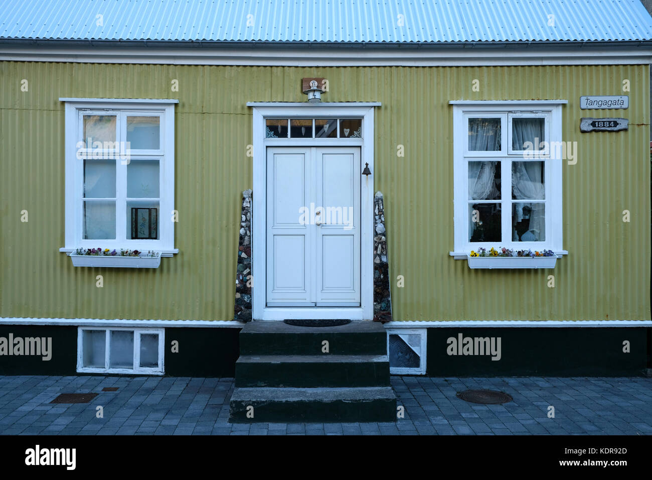 Traditional Icelandic wooden yellow house front in remote Westfjords town of Isafjordur Iceland - Stock Image
