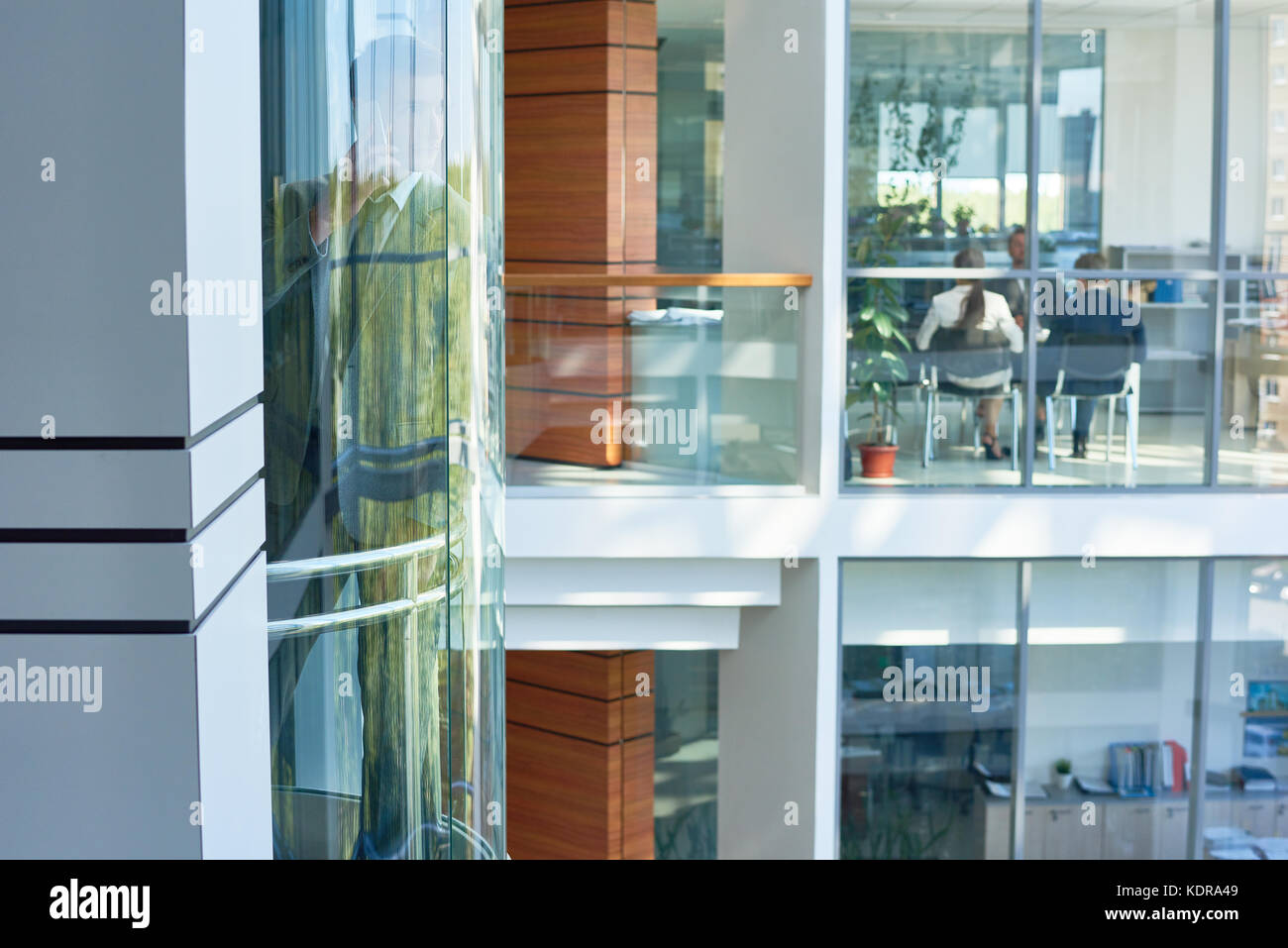 Interior of Busy Office Building - Stock Image
