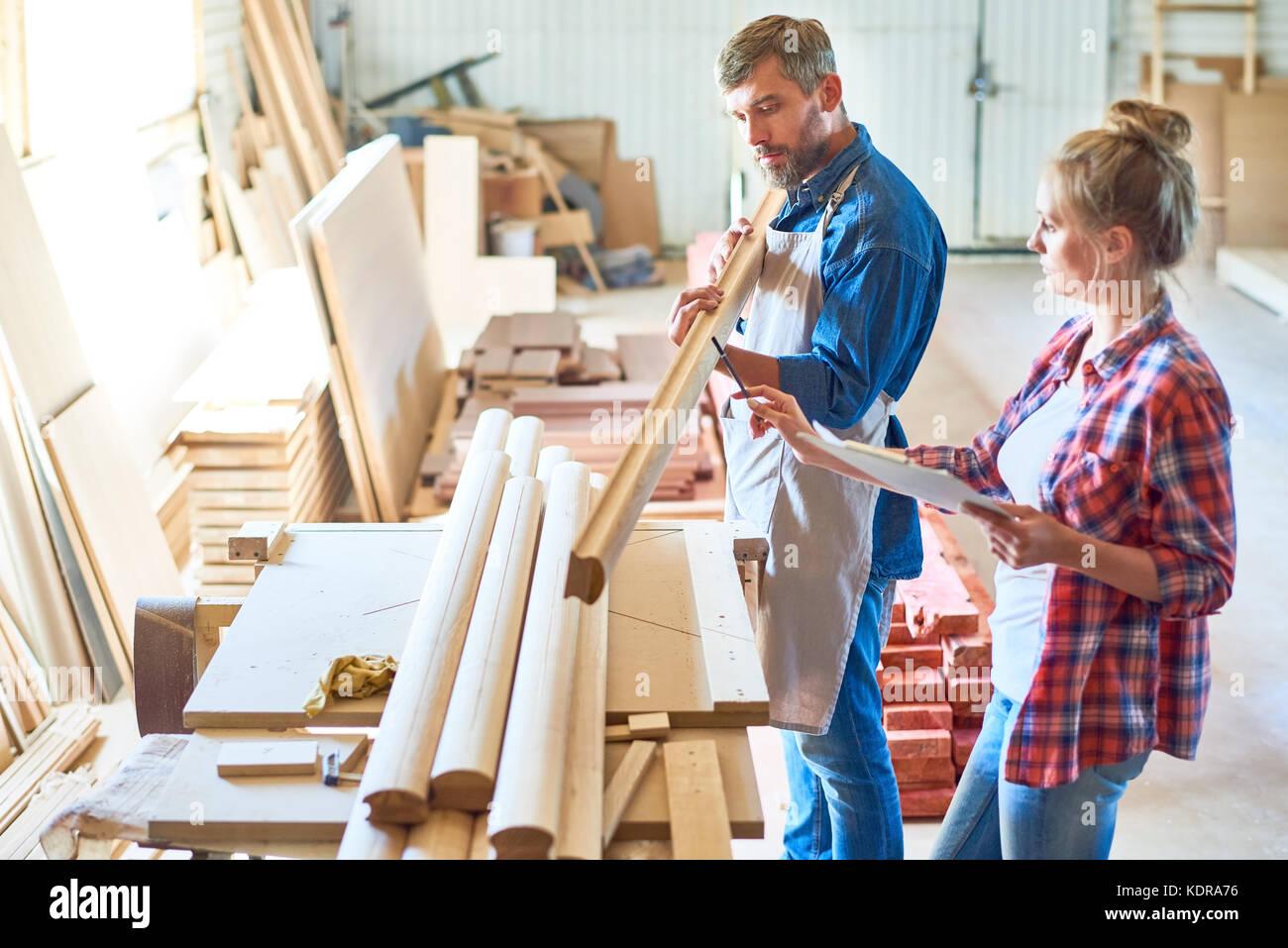 Modern Carpenters Choosing Wood - Stock Image