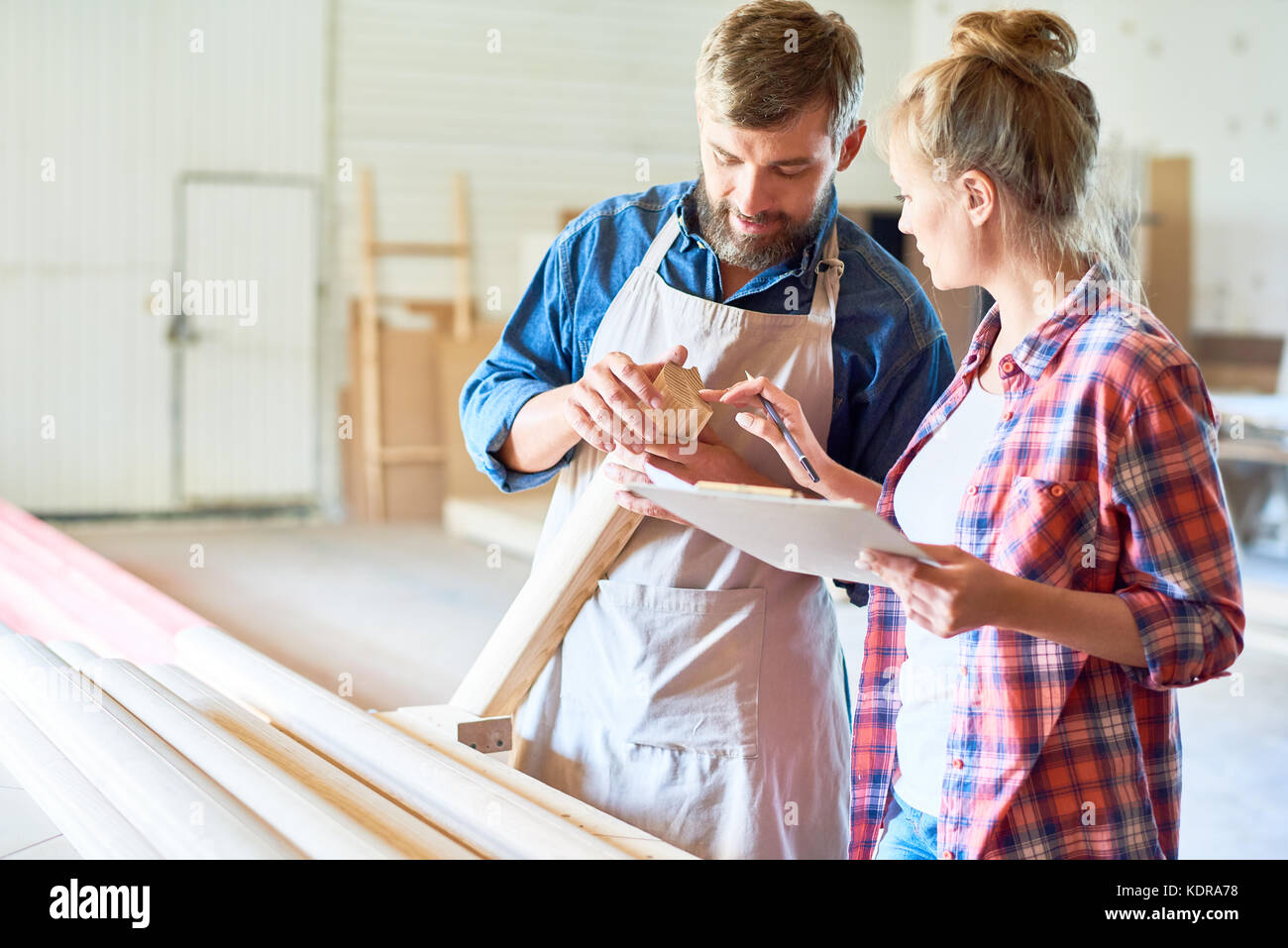 Modern Carpenters Choosing Wood in Joinery - Stock Image