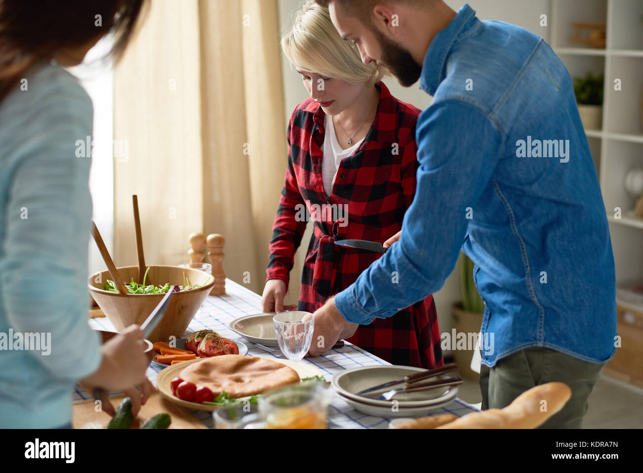 Young Friends Making Dinner - Stock Image