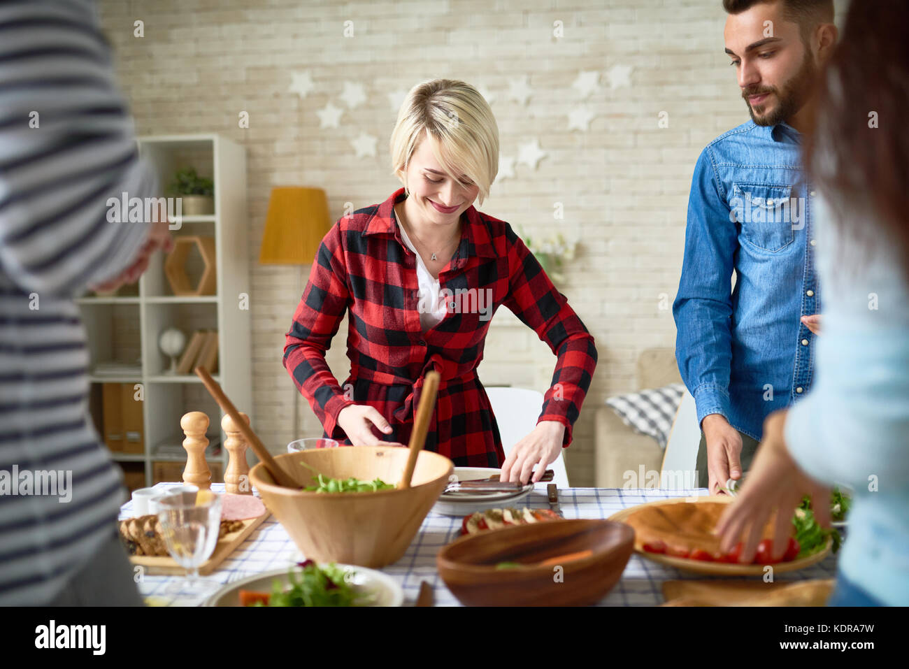 Young People Making Dinner Together - Stock Image