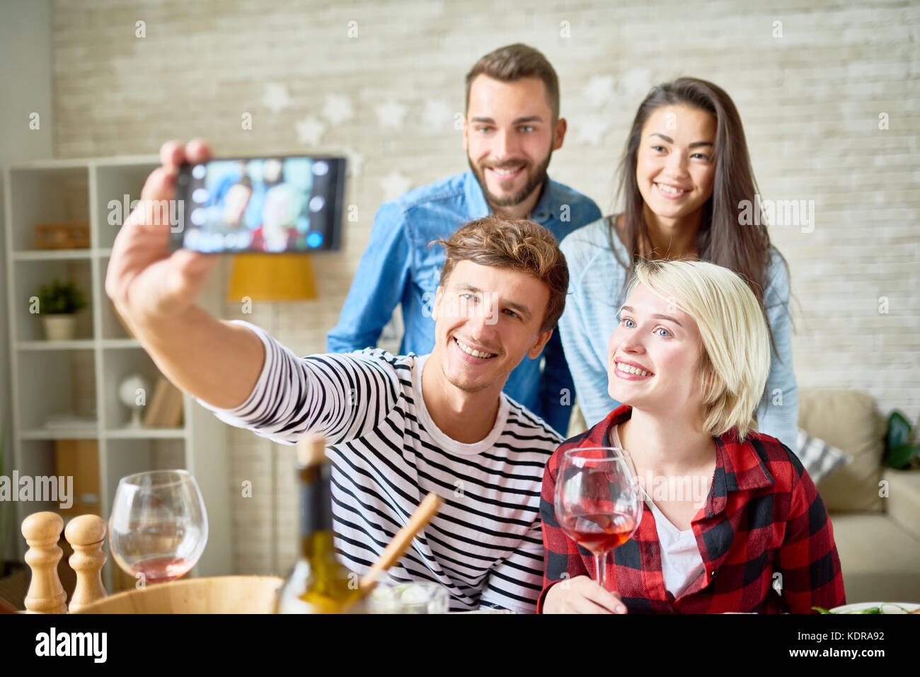 Happy Young People Posing for Selfie - Stock Image