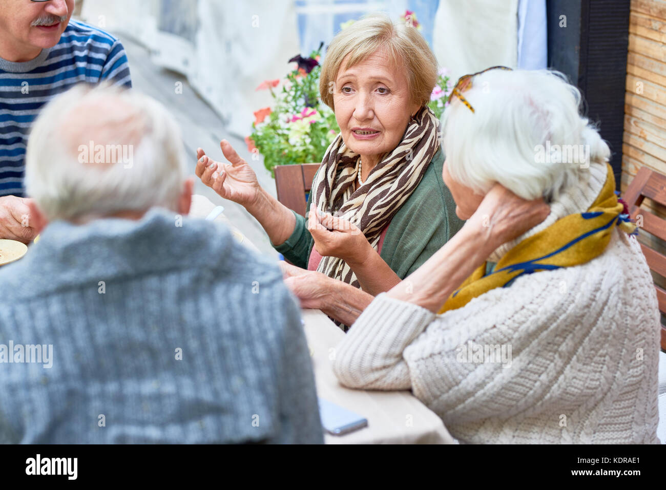 Senior Friends in Cafe Together - Stock Image