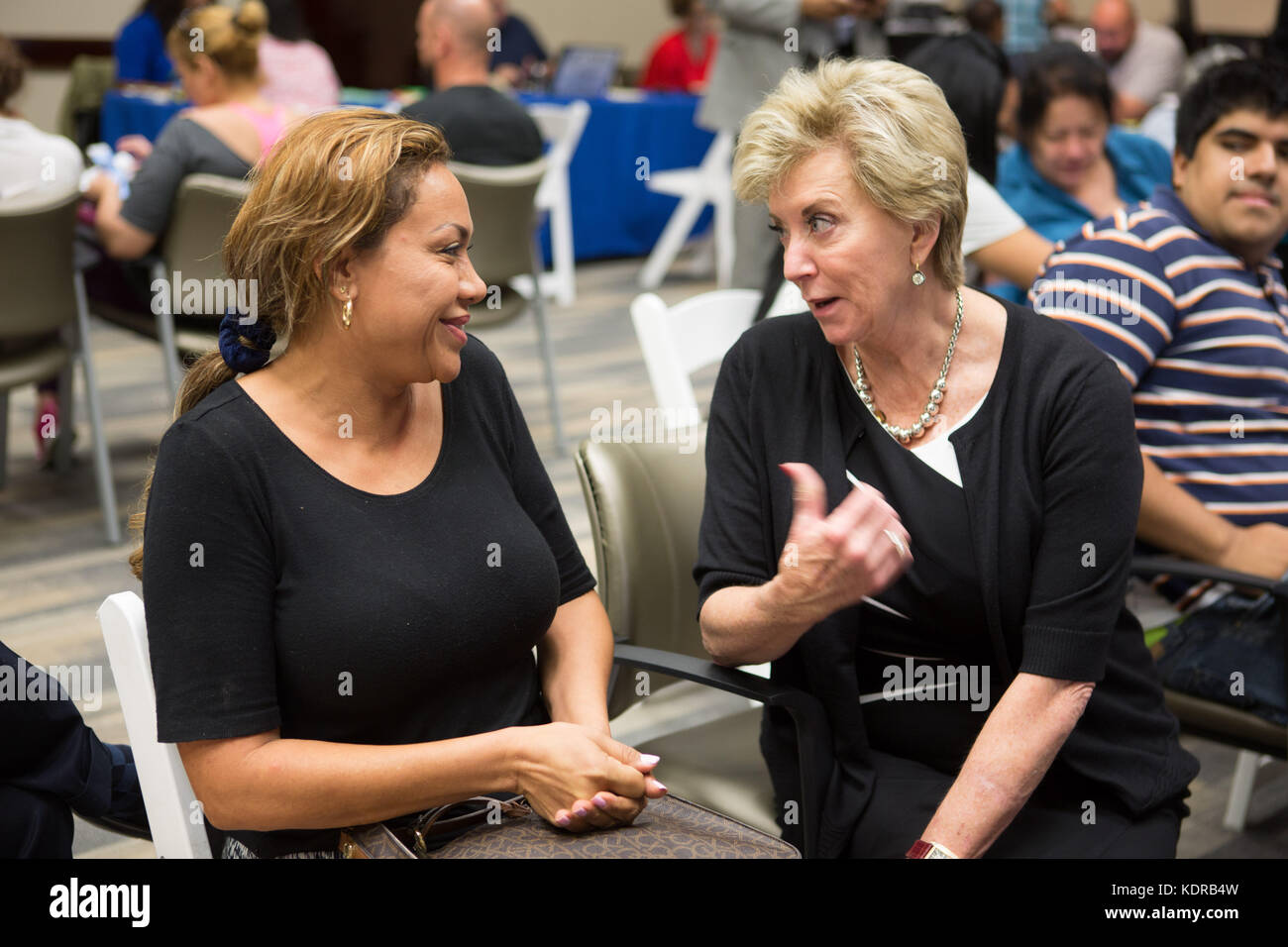 U.S. Small Business Administration Administrator Linda McMahon (right) speaks to a Florida resident in the aftermath - Stock Image