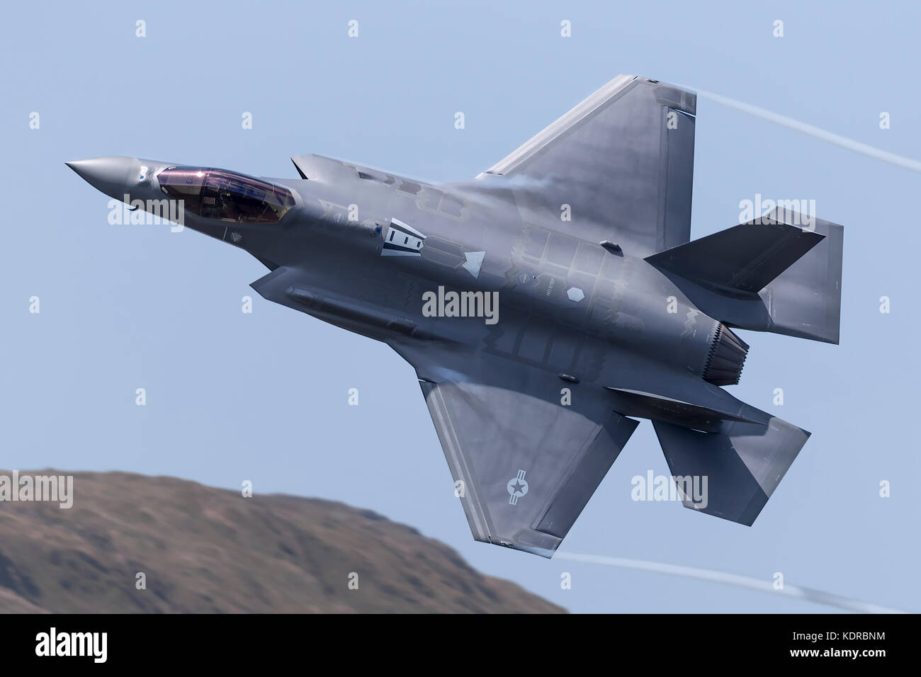 F35 Joint strike fighter going through the Mach Loop in Wales for the first time 17/05/02 - Stock Image