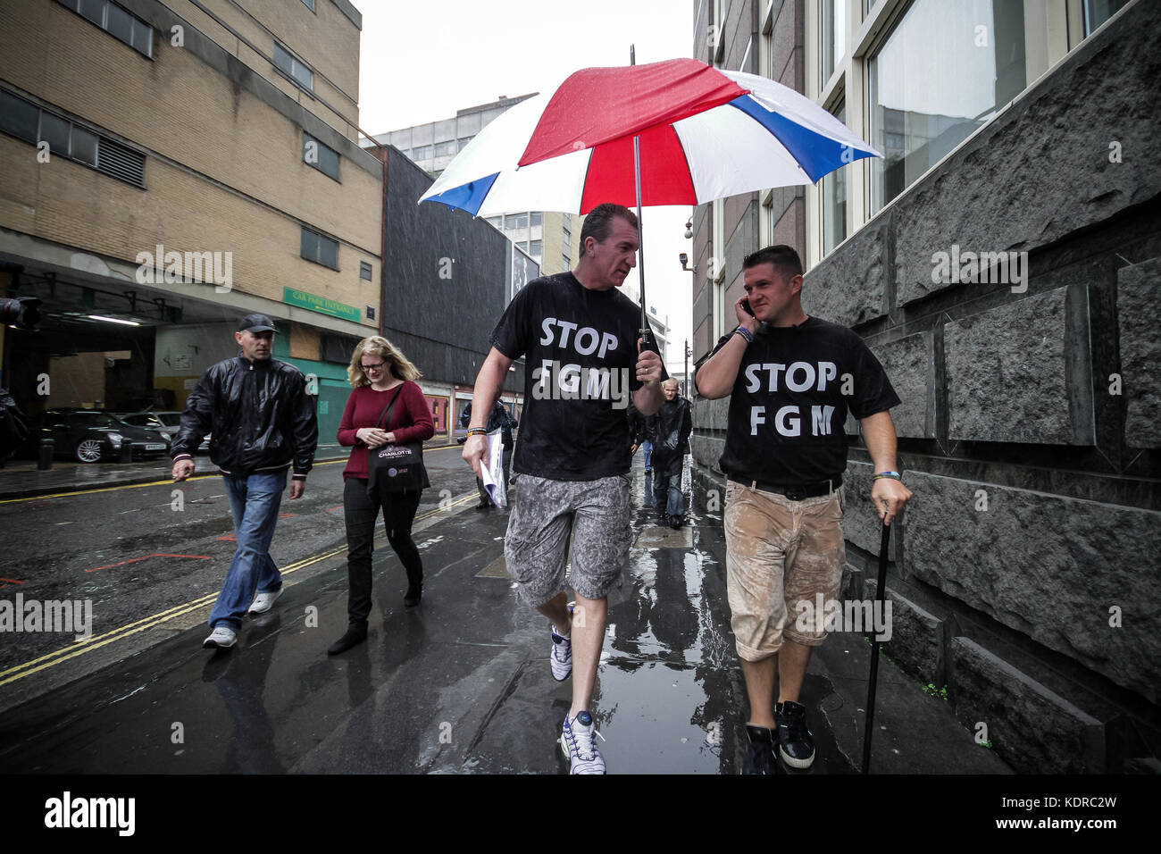 Tommy Robinson and Kev Carroll, leaders of the English Defence League (EDL) stage a sponsored charity walk through - Stock Image