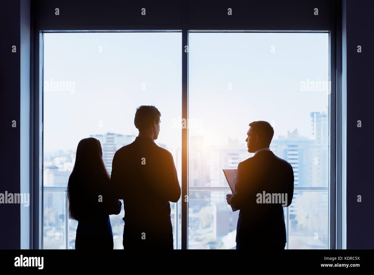 Couple and real estate agent window deal concept - Stock Image