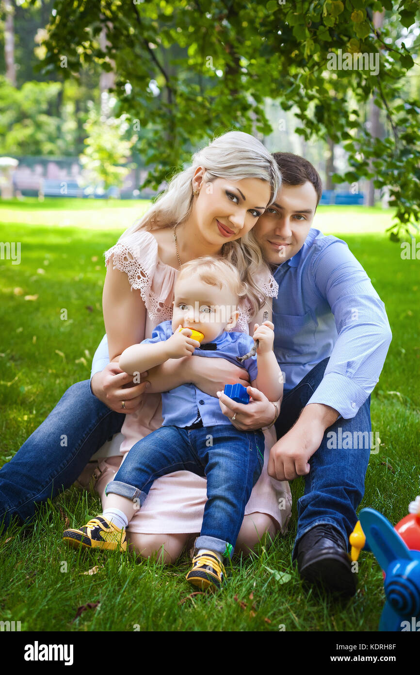 glad family on city park - Stock Image