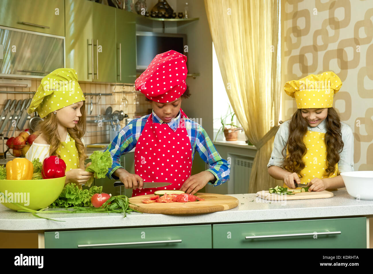 Children in the kitchen. - Stock Image