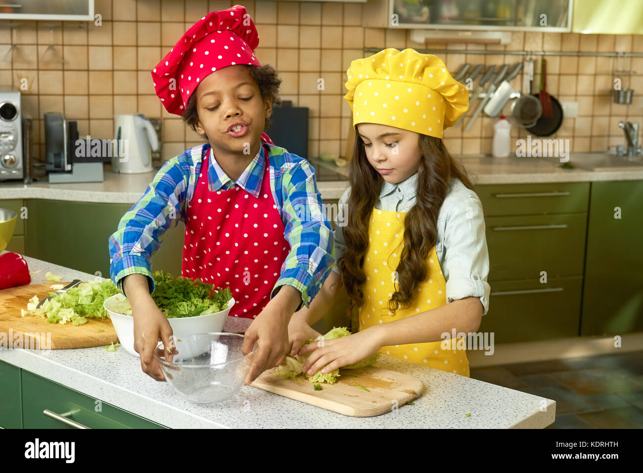 Boy and girl cooking, kitchen. - Stock Image