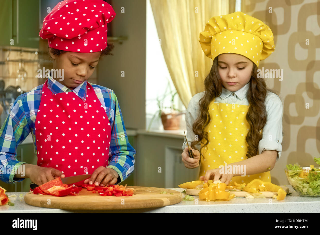 Boy and girl cooking. - Stock Image