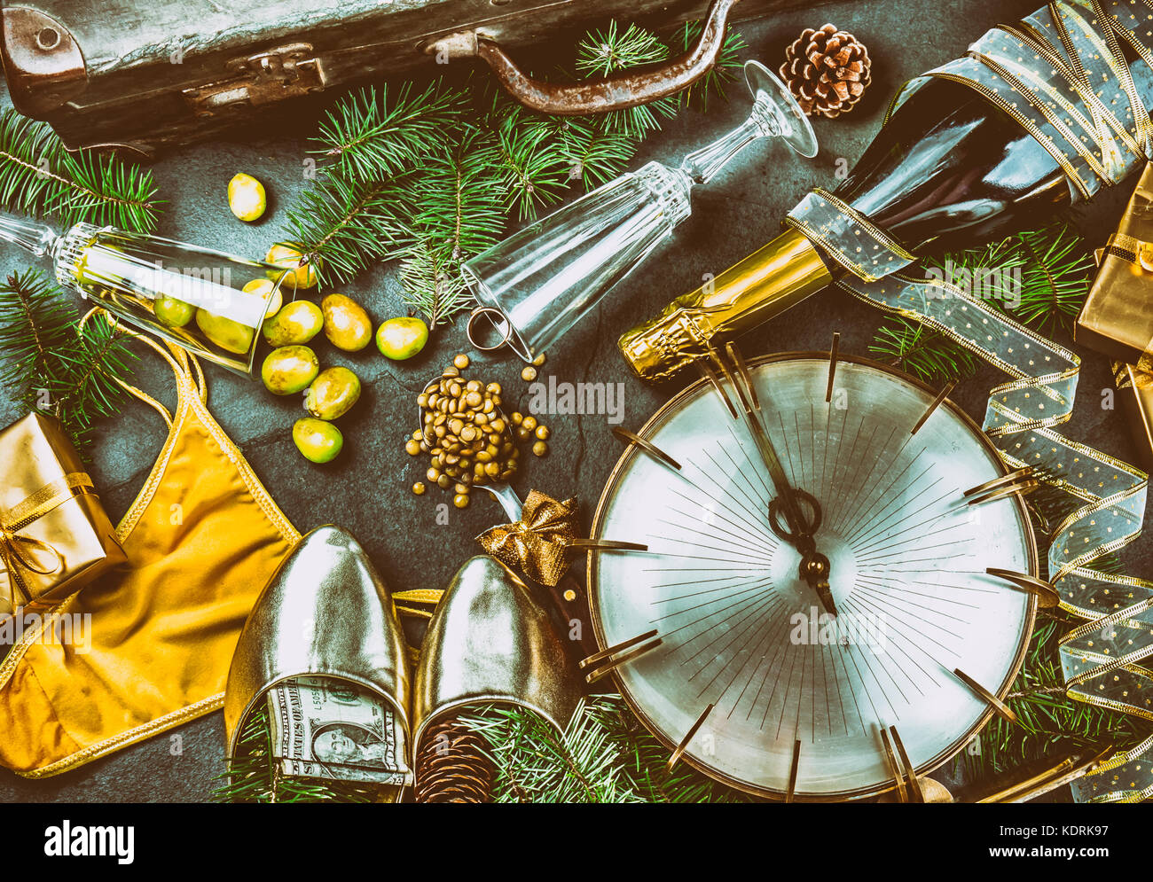 LATIN AMERICAN AND SPANISH NEW YEAR TRADITIONS. empty suitcase, lentil spoon, yellow interior clothes, gold ring - Stock Image