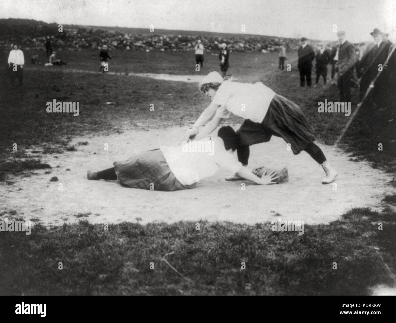 Baseball - New York Female 'Giants': Miss Schnall, catcher, and Miss Slachu with hands on home plate, July - Stock Image