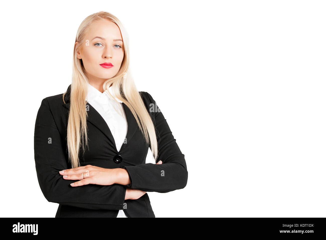 Half-length portrait of beautiful smiling blonde  standing aside cross-armed looking at us. Isolated on white background - Stock Image