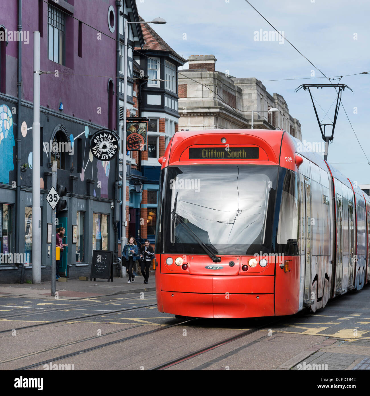 Red Incentro AT6/5 model Tram, Goldsmith's street, Nottingham - Stock Image
