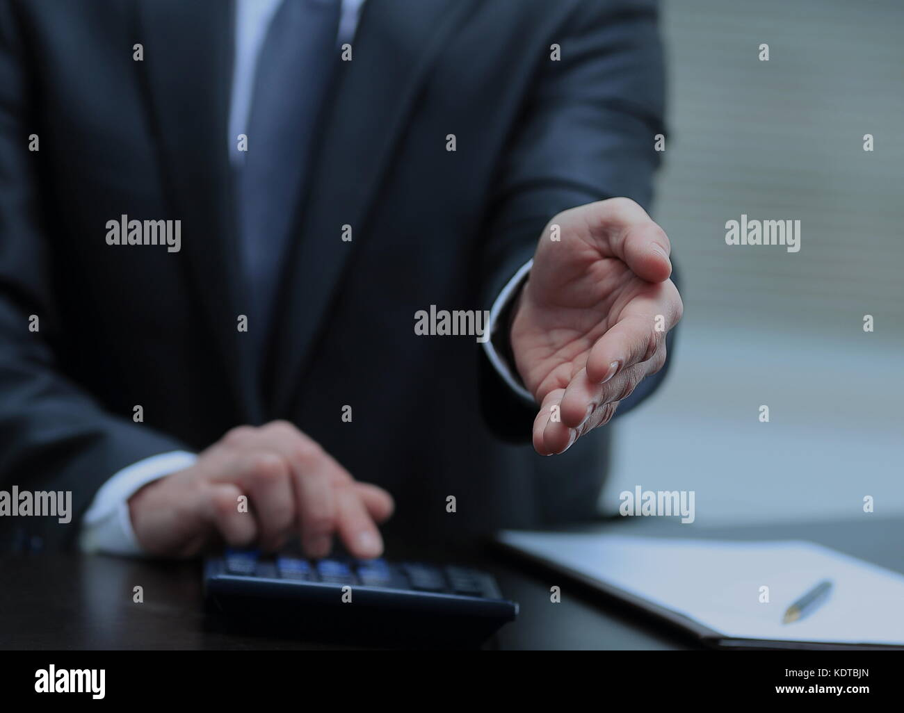 A business man with an open hand ready to seal a deal - Stock Image