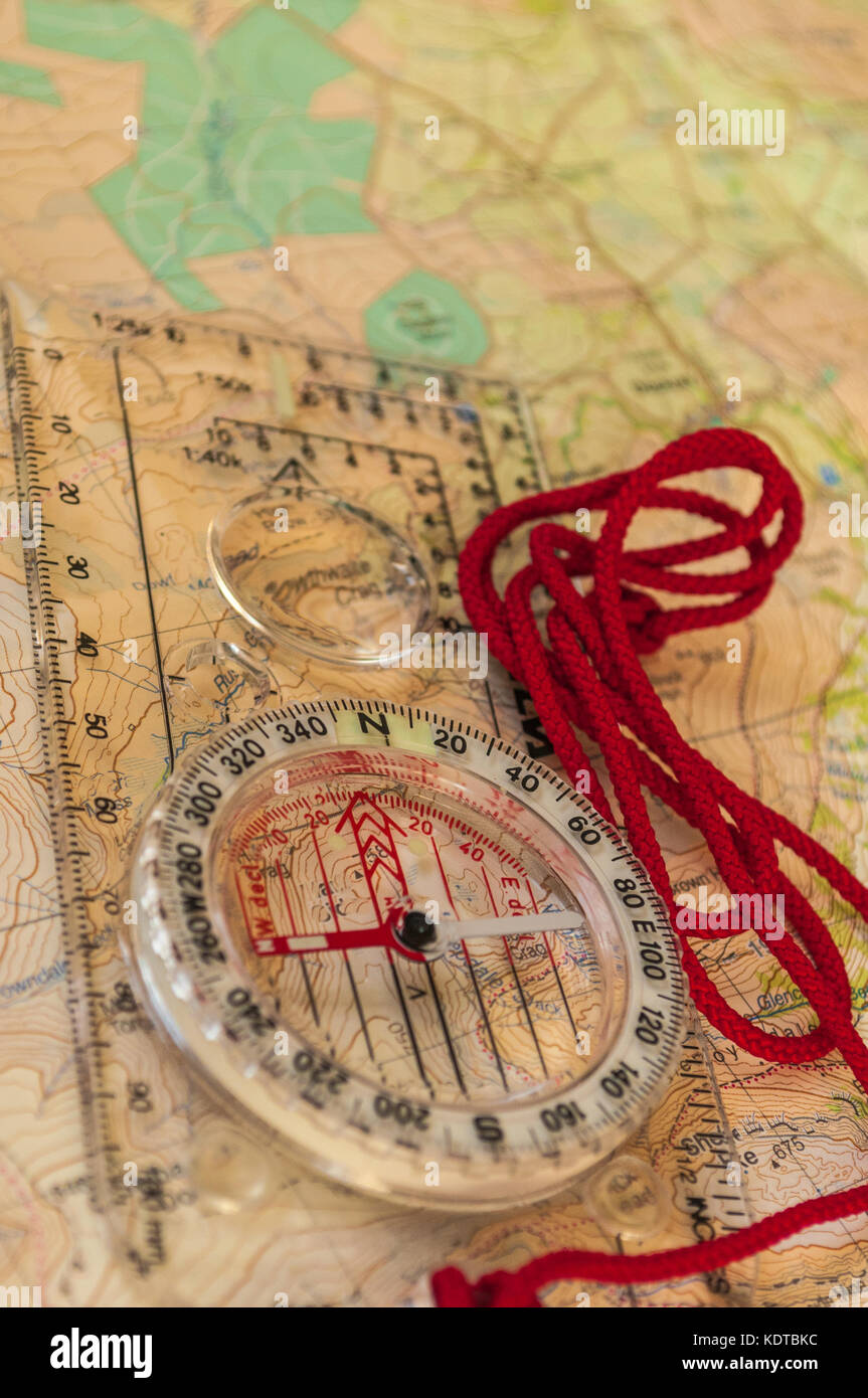 Compass on Map, The focus is on north of dial with shallow depth of field - Stock Image