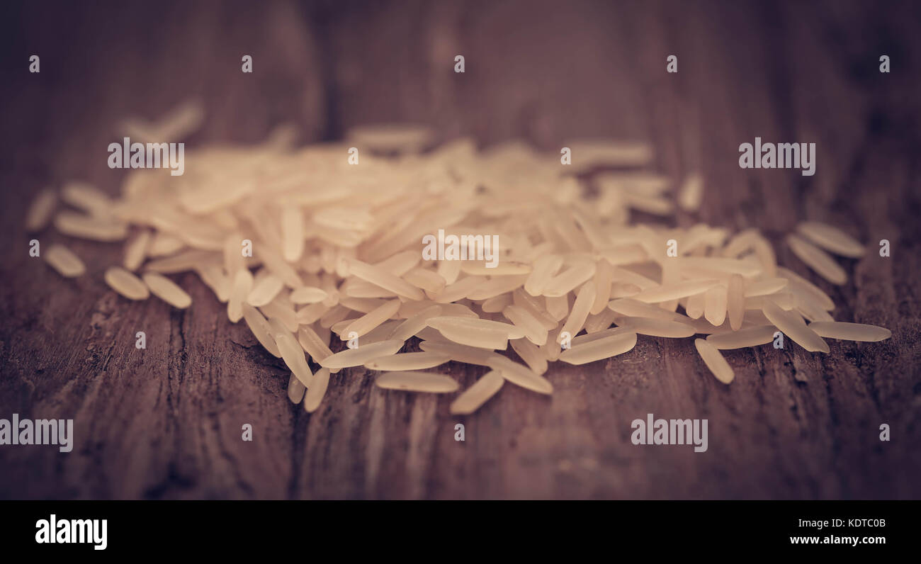Basmati rice uncooked on natural surface - Stock Image