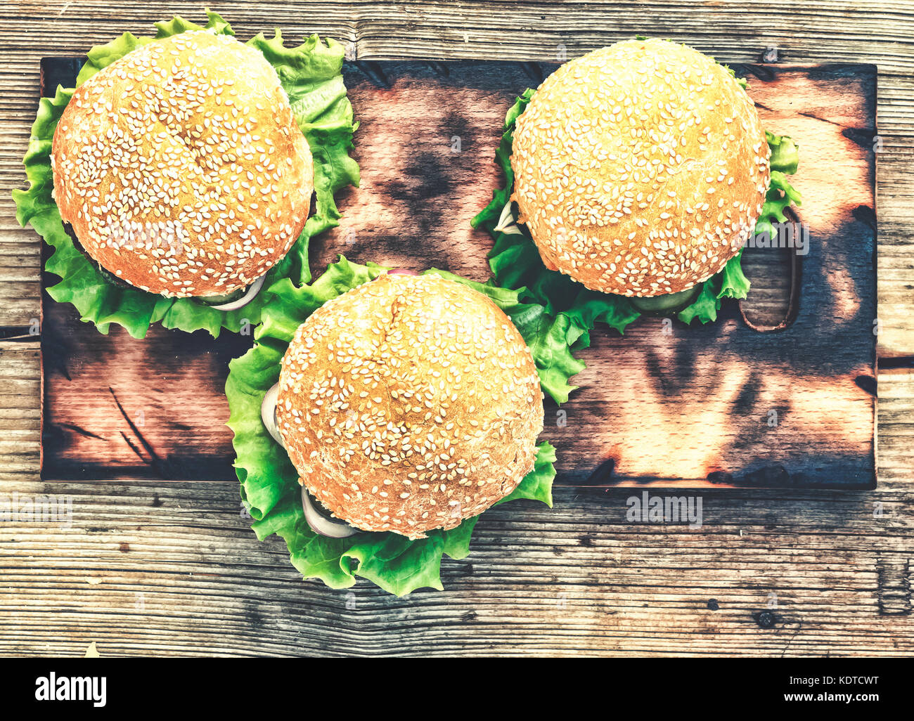 Hamburger on a wooden table. Rustic style, top view Stock Photo