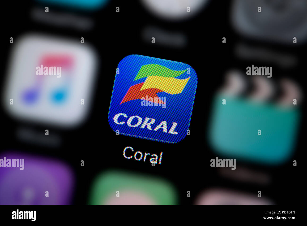 A close-up shot of the logo representing the Coral betting app icon, as seen on the screen of a smart phone (Editorial - Stock Image