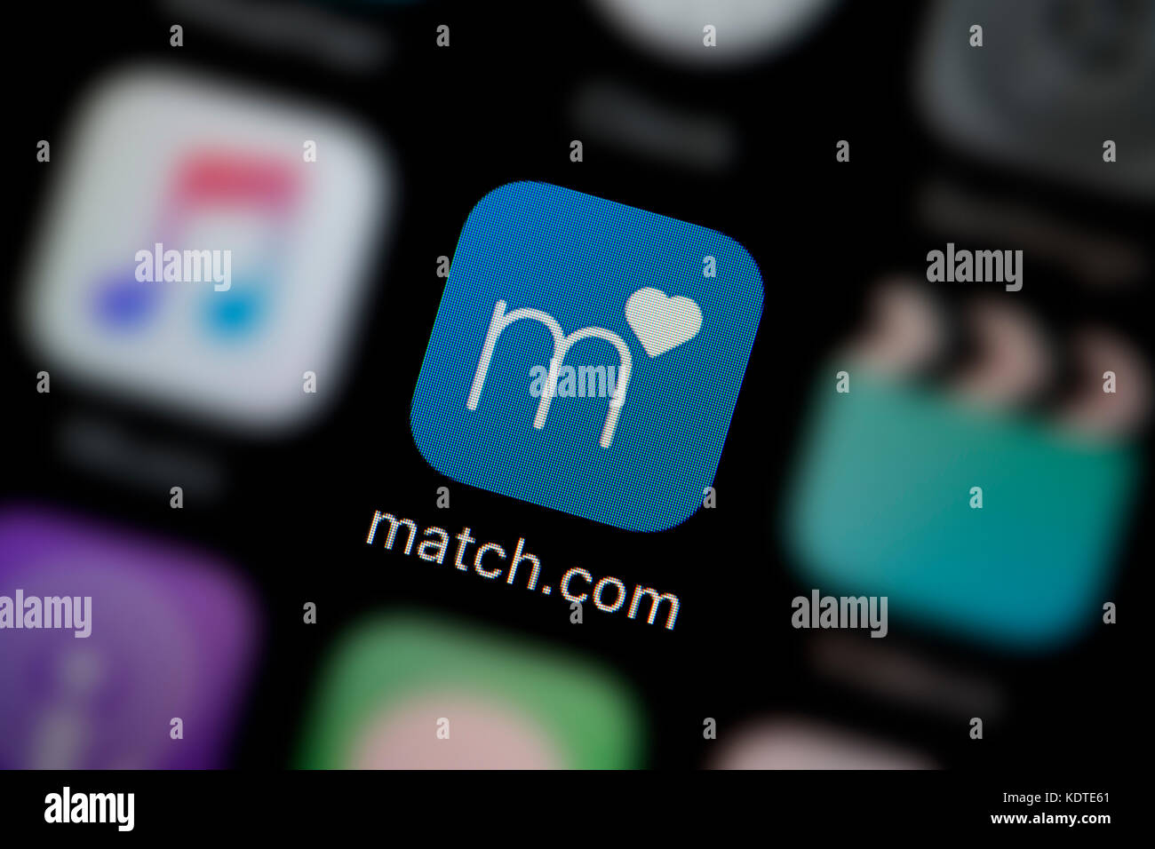A close-up shot of the logo representing the Match.com app icon, as seen on the screen of a smart phone (Editorial - Stock Image