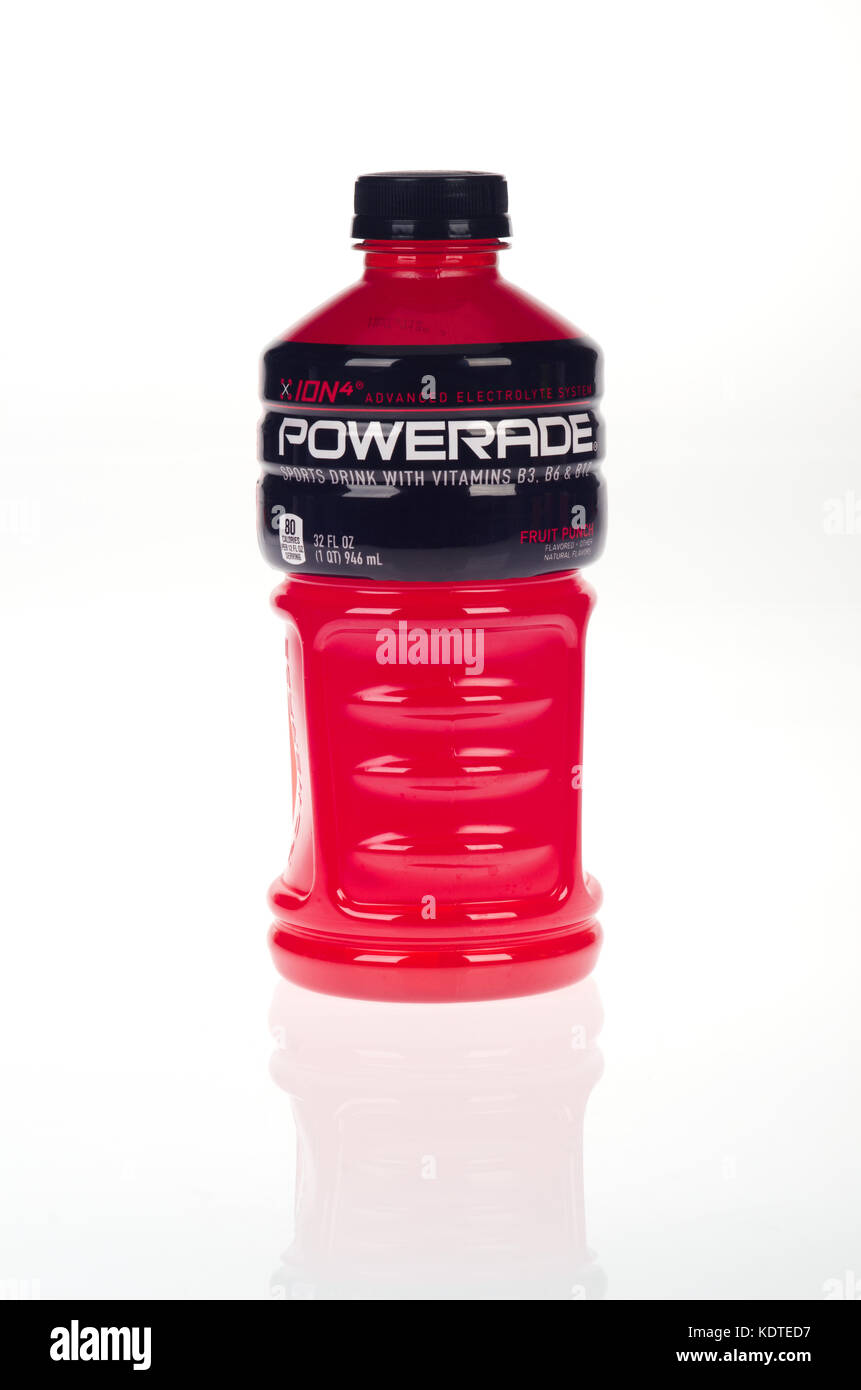 Plastic bottle of fruit punch flavored Powerade sports energy drink  by the Coca Cola Company on white background - Stock Image