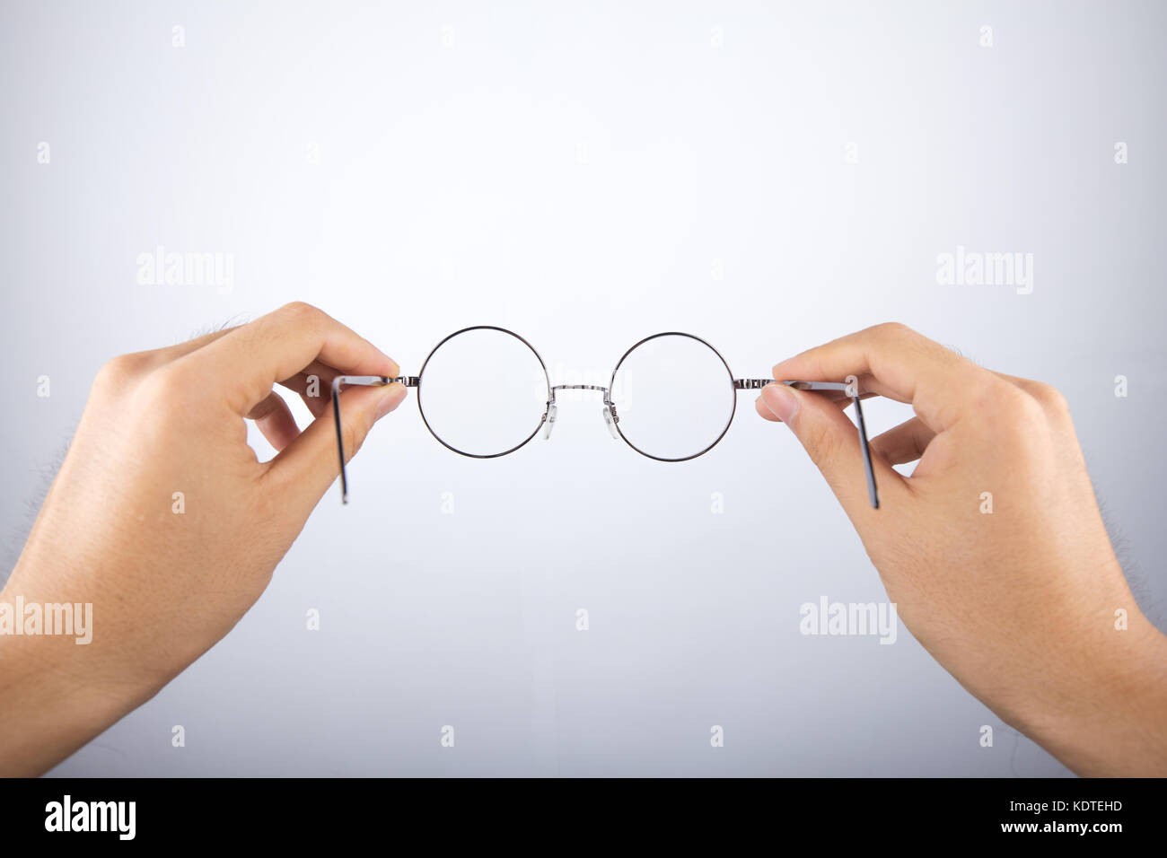 d93a92780cfb1 hand holding circle glasses Stock Photo  163422153 - Alamy