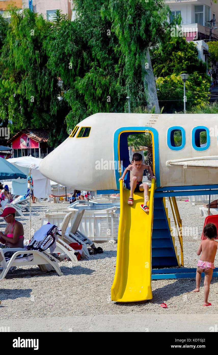 Saranda Beach playground with airplane and yellow slide, Vlore County, Sarande, Albania. - Stock Image