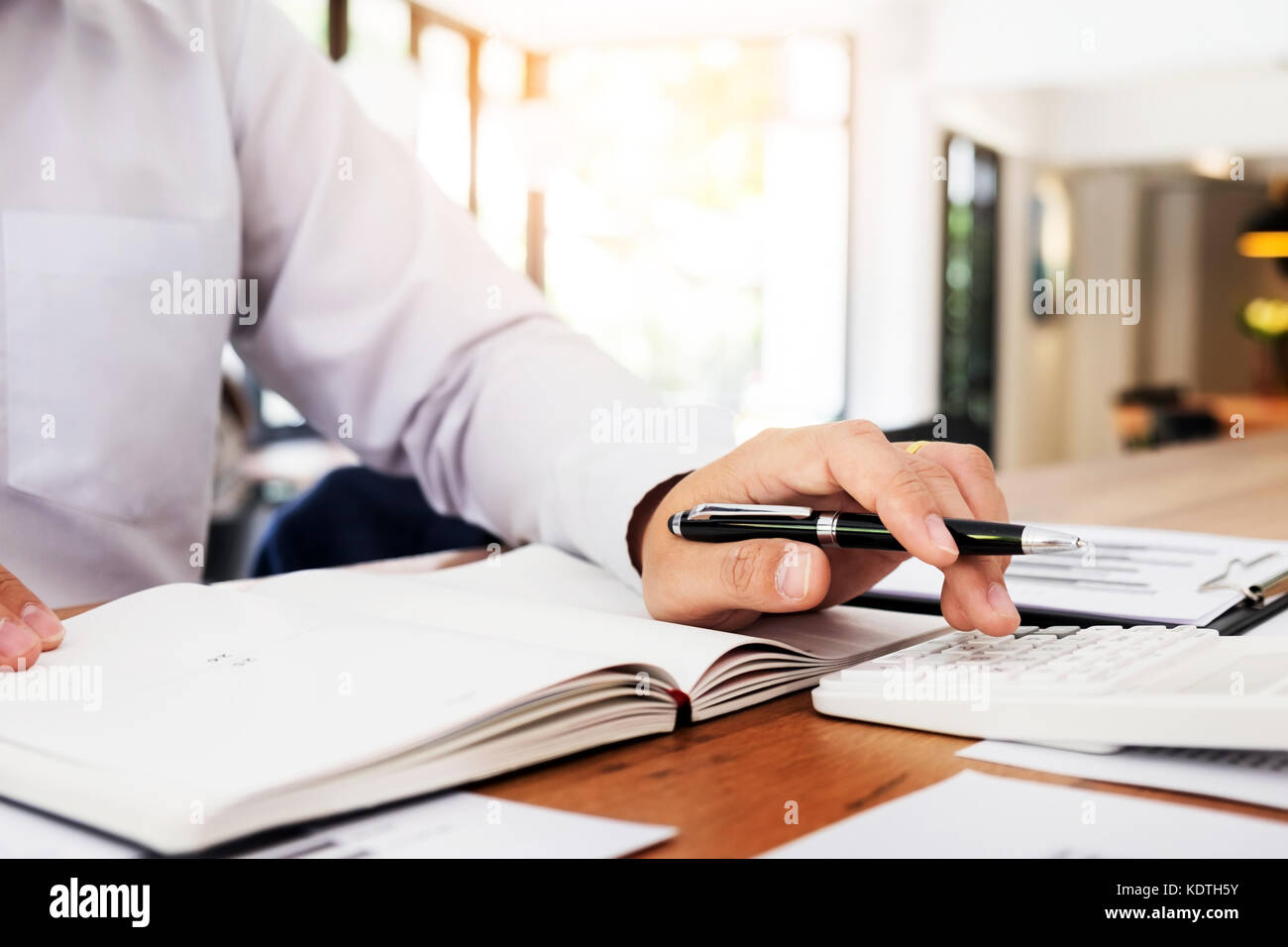 Accountant or banker calculating balance. finances investment economy saving money or insurance concept - Stock Image
